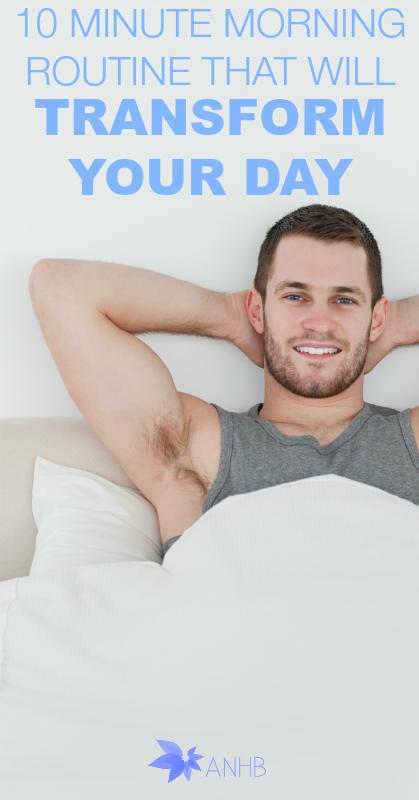 Happy man waking up in his bedroom